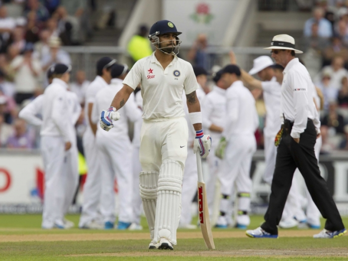 Virat Kohli walks from the pitch after losing his wicket at Old Trafford.